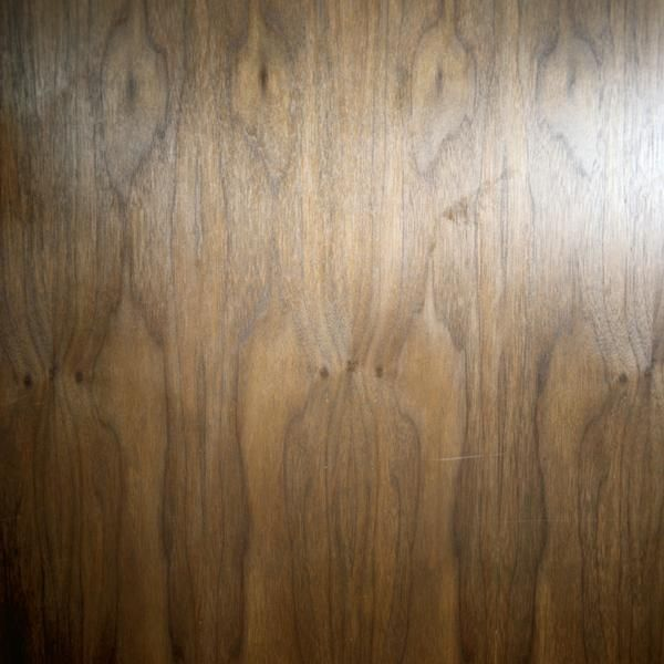 Use a wood-graining tool to faux finish a metal door.homeguides.sfgate.com