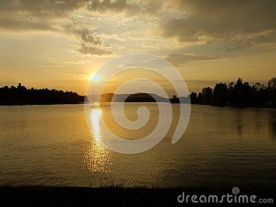 Sunset above a lake with a fountain in central city of Boden, Sweden.