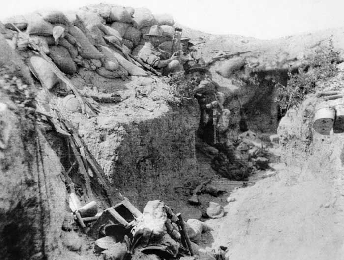 This photograph shows a section of the captured Turkish Trenches at Lone Pine in August 1915. Seated and looking at the camera with what looks to be a trench periscope in his hands is Lance Corporal Leonard Keysor, 1st Battalion, AIF. Keysor was awarded the Victoria Cross for his bravery at Lone Pine on 7 August. The AWM caption states that this image shows 'three survivors after a bombing' and we must assume this means after a Turkish bombing attack so the photo was taken during the days of…