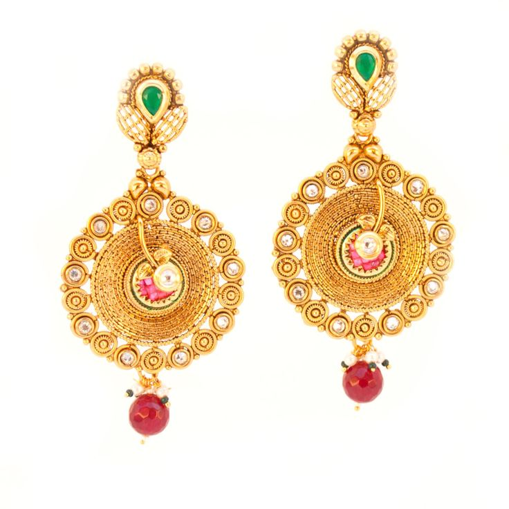 Matte antique gold plated ethnic rajwada Jodha Akhbar long dangle earrings studded with kundan stone in the middle and red drop glass stone. Limited Availability. Metal: Alloy Plating: 5KT (1 gram) Go