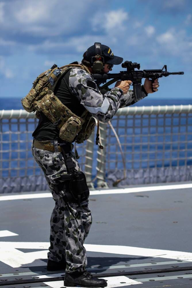 A Royal Australian Navy clearance diver doing some training aboard ship