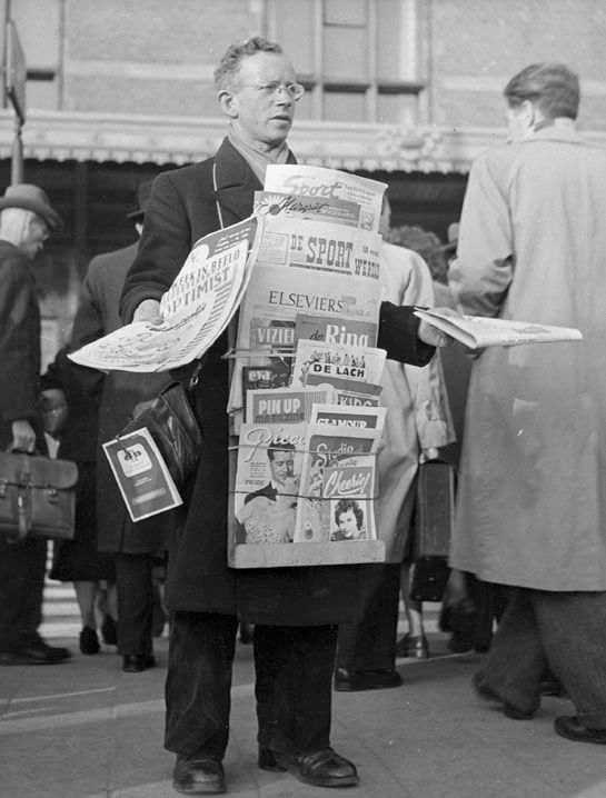1954. Selling newspapers at Centraal Station in Amsterdam. Photo Kees Scherer. #amsterdam #1954 #CentraalStation