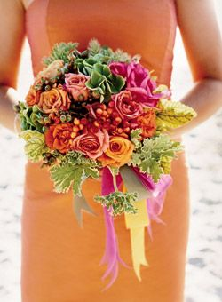 Brides: Dahlia and Tuberose Wedding Bouquet. Ribbon-festooned bouquets of the bride's favorite flowers—dahlias, tuberoses and hydrangeas—complement the bridesmaids' strapless, tea-length coral dresses.