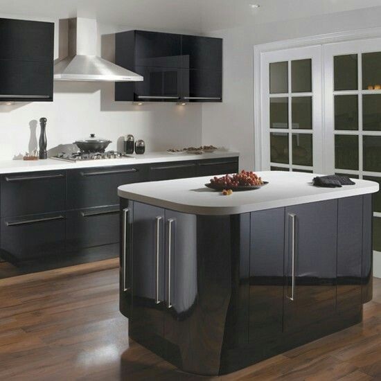 Charcoal cabinetry/white bench tops