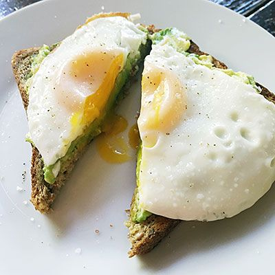 Top your traditional avocado toast with a fried egg for extra energy-boosting protein. Hint: Be extra on-trend by frying the egg with coconut oil. | Health.com