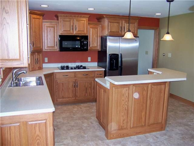 Red oak cabinets raised panel doors and side panels for Kitchen cabinets and countertops designs