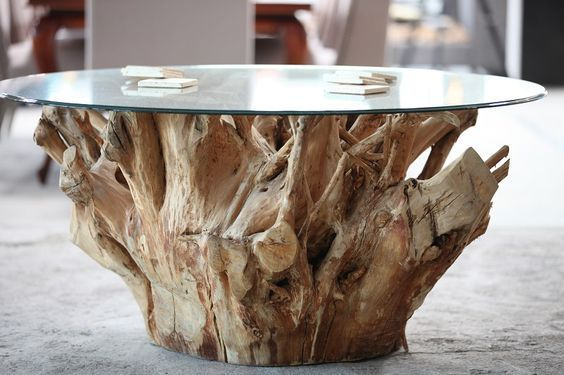 JABIN ROOT WOOD DINING TABLE Handpicked for its natural beauty, this solid wood design is painstakingly coaxed.