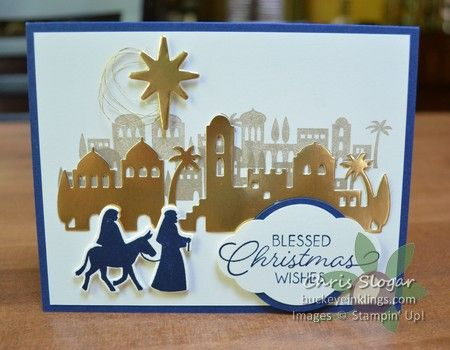 """I was really excited to break out this set! """"Night in Bethlehem"""" and the coordinating Bethlehem Edgelits Dies create a suprisingly easy """"WOW"""" card. I stamped the rooflines in Crumb Cake, one at full strength and the second staggered from the first and stamped off. (Stamping off means tapping some of the ink from the stamp onto scrap paper before stamping onto the project. This creates a lighter image.) Then I added a few gold elements, and they really steal the show - ..."""