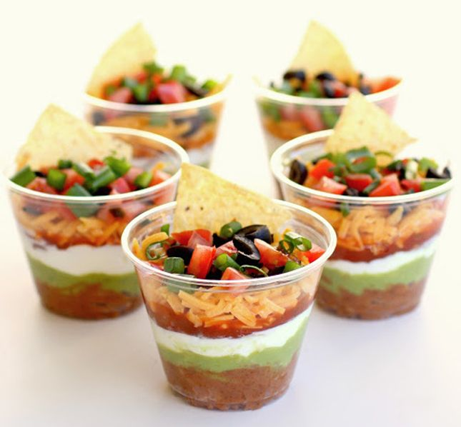 Refried beans, guacamole, sour cream, salsa, shredded cheese and rice pico de gallo.  Served with nacho chips can be an appetizer or snack on its own or use at a gathering to prevent double-dipping.