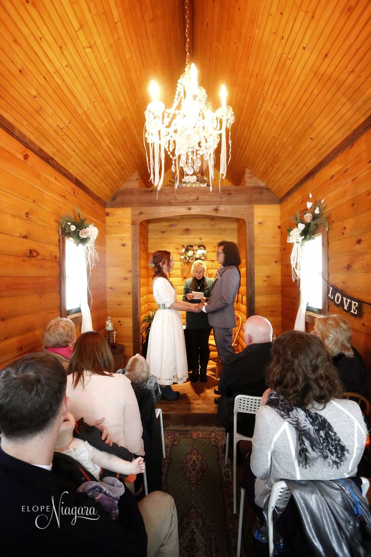 Inside our charming and cozy little log wedding chapel in Niagara