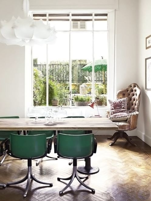 bleached wood table, oversized window, armchair in corner...