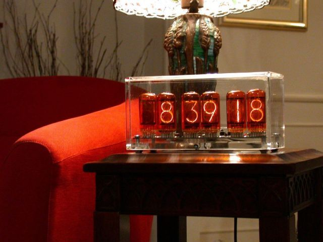Nixie tubes are essentially like neon lamps. They give a lovely retrofuturistic look to any room, and are not too warm to touch.