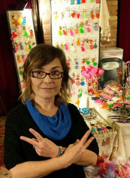 At Artisan craft shows I ask my kid to take my picture and at the last minute I put on my mean face and my 'gansta' trademark.