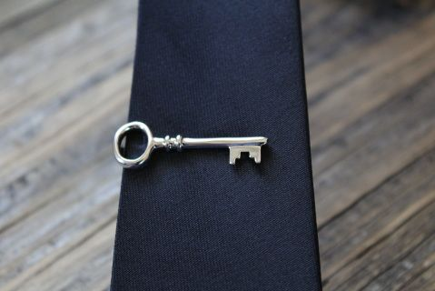 Tie Bar Key will polish off any outfit. Great with skinny ties because of it's smaller size.