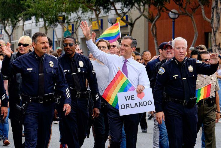 Caption: Eric Garcetti marches in L.A.'s gay pride parade, June 2016 - (AP Photo/Richard Vogel)