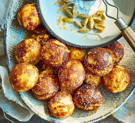 These comforting round buttermilk pancakes are spiked with citrus and spice. A traditional Danish bake, they're called aebleskiver. It's all about hygge!