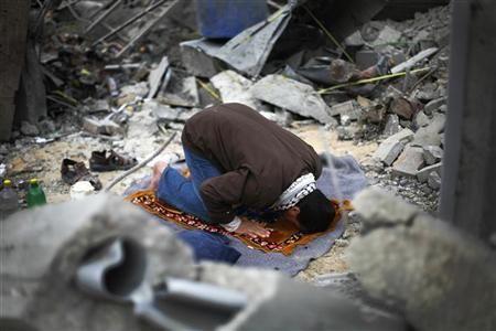 Palestinian Man Prays in Destroyed House