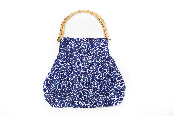 Handbag made of vintage fabric in blue colours.