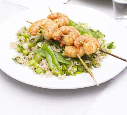 Miso prawn skewers with veggie rice salad. For a new way with prawns, marinade in soya, serve as kebabs and team with healthy basmati.