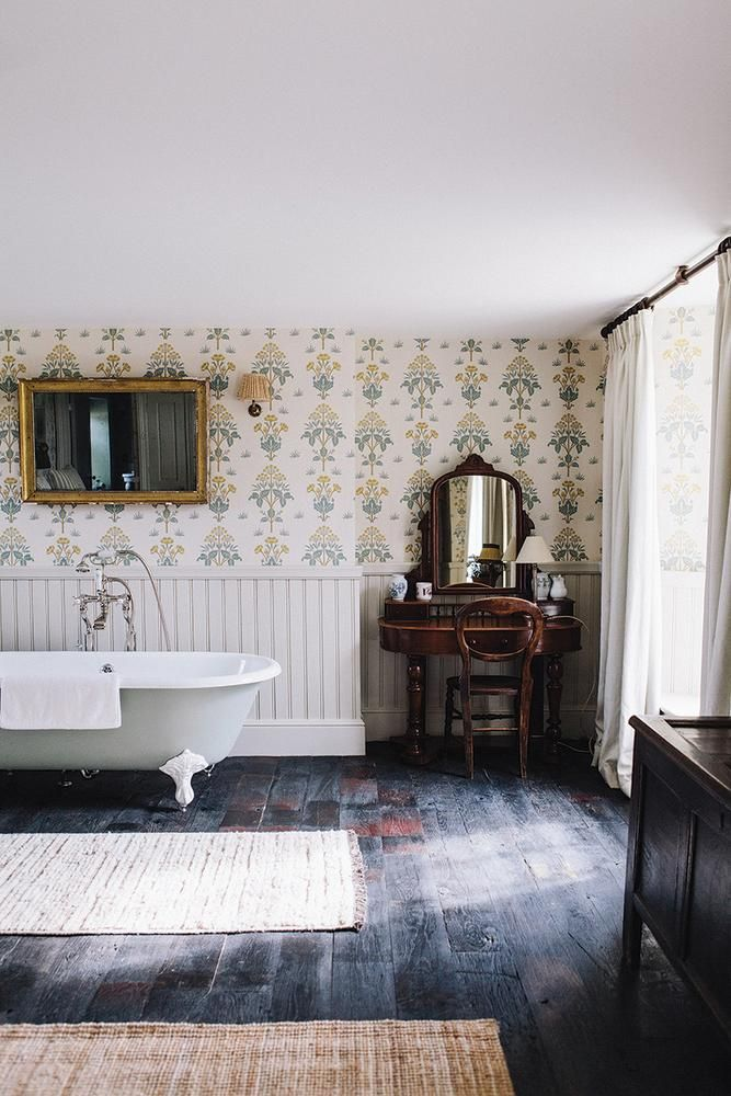 claw foot tub | Soho Farmhouse - stunning wallpaper, stripped back flooring, classic furniture and gold accents.