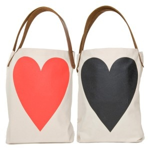 """Two-sided Heart ToteThis bag is awesome!    Organic cotton with leather handles. Bottom gusset so it can take your laptop to work and then some. Little hanging pocket inside makes it easier to find your wallet and keys. Hangs just right and made in the USA. About 16 x 18"""""""