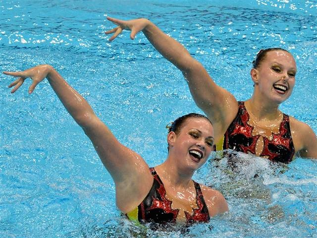 Piling on the makeup is usually a beauty don't, but not for these athletes...Mary Killman and Mariya Koroleva spend up to eight hours a day practicing their synchronized swimming duet for the Olympic Games this summer.