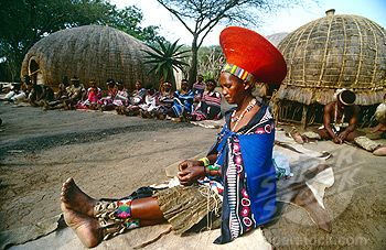 Zulu women wearing their isicholos/inkehlis - a wide hat decorated with beads (ubuhlalu) - worn by married Zulu women during special occasions and ceremonies.