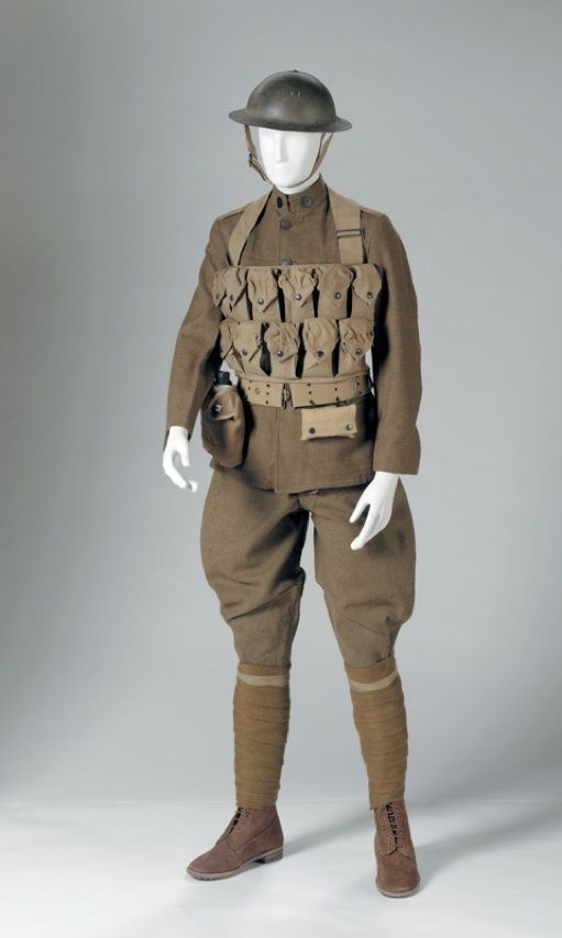 The 1918 American Doughboy uniform of the American Expeditionary Force (AEF) was patterned after the British uniform of the period.  Wool with metal fastenings, metal helmet, reproduction leather boots.  The grenade vest shown here was an ill-conceived government response to the need to carry more explosives. This vest was not popular with front line troops.