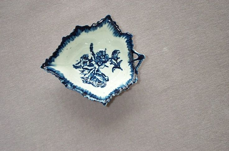 A rare Derby blue and white pickle dish with a shaped and serrated edge A rose and other flowers painted to the centre and vein moulding to the back. Unmarked  Circa 1768 Length 4  1/4""