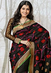 An occasion wear perfect is ready to rock you. This black raw silk saree have beautiful embroidery patch work which is embellished with resham and zari work. Fabulous designed embroidery gives you an ethnic look and increasing your beauty. Matching black viscose blouse is available. Slight Color variations are possible due to differing screen and photograph resolutions.