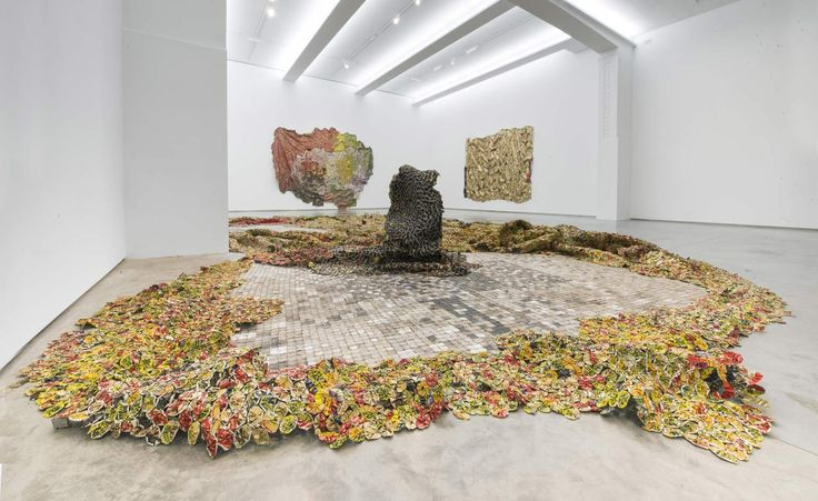 Anatsui's 2012 'Tiled Flower Garden', which snakes 30 feet across the gallery floor