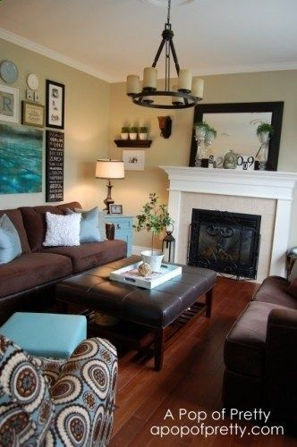 DARK BROWN COUCH, TAUPE WALLS AND LIGHT BLUE ACCENTS