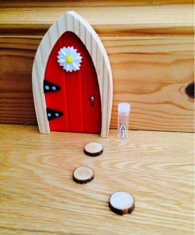 The Irish Fairy Door Company sweet little fairy door - red door with stepping stones and tiny fairy key #fairydoor