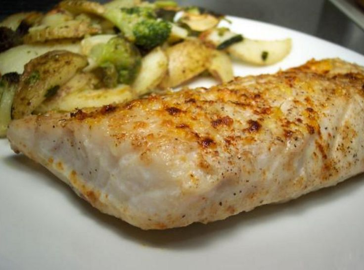 This recipe and this bass were both given to me by my husbands co-worker. I can honestly say that this is the best broiled filet of fish I ever ate!!! The butter, the wine, the lemon zest and the parmesan cheese all go so well with this fish! Thank you Jim Speer!!! I added my photo.