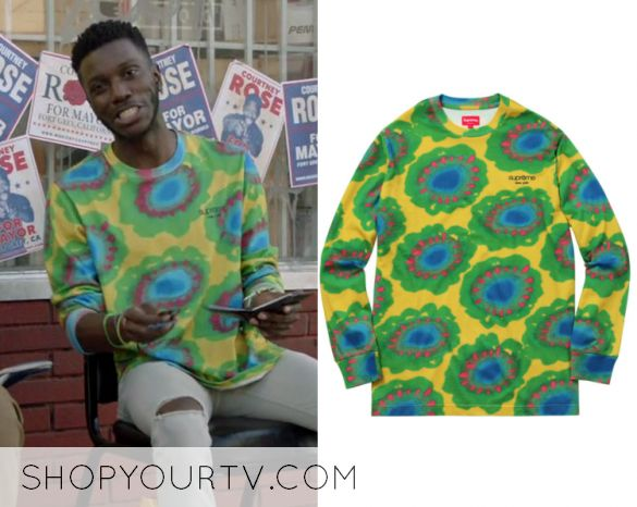 "Jermaine Leforge (Bernard David Jones) wears this multi colored dyed flower printed sweater in this episode of The Mayor, ""Pilot"". It is the Supreme Painted Flowers L/S Tee"