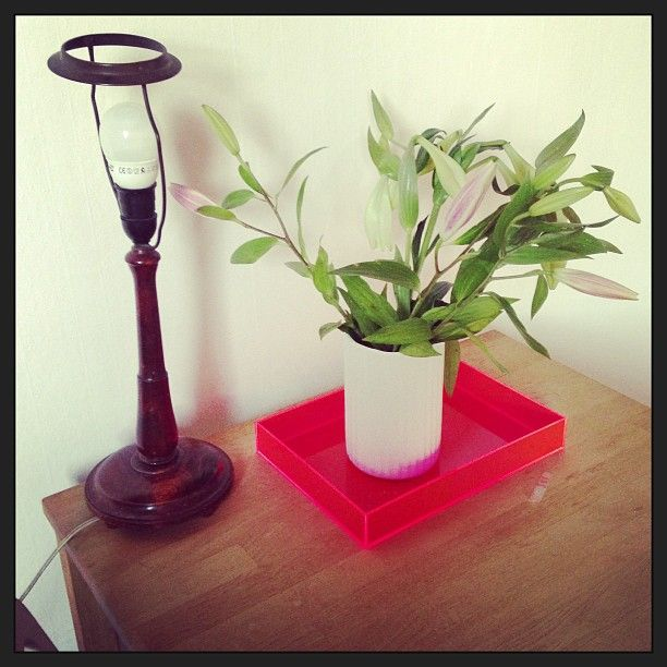 Vintage lamp, neon tray and lillies.