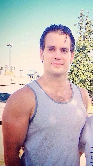 Telling you that I wanna rip that tank top off your gorgeous body with my teeth has put a small smile on your face huh Cavill? Lol!! ;)