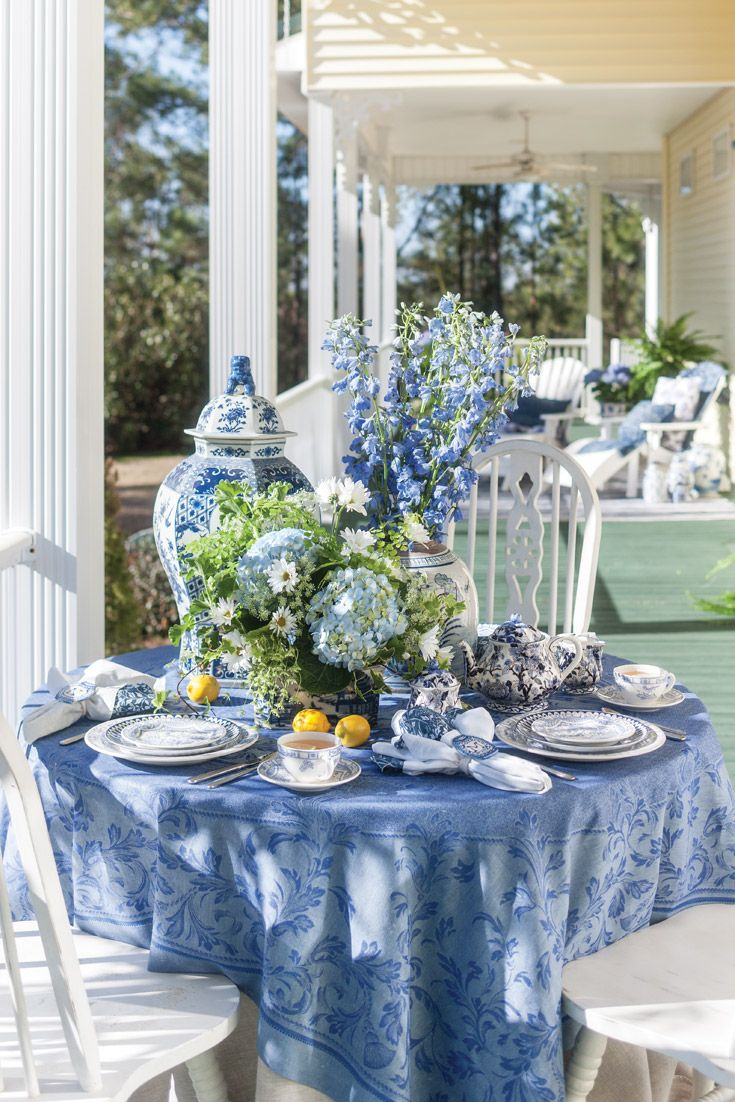 Atop A Linen Way Tablecloth Oriental Danny Decorative Vases Form An Eye Catching Centerpiece Get More Blue An Blue White Decor Blue Table Settings Blue Decor