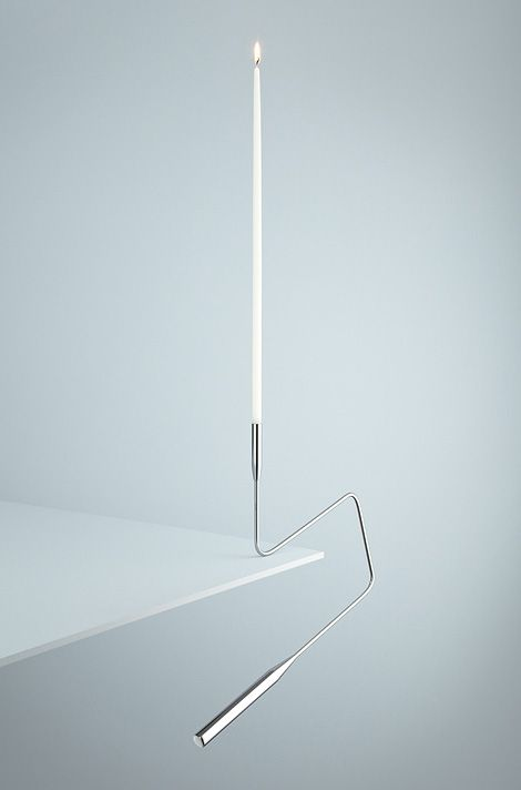 'Poise' is a counter-weighted candlestick designed to balance over a shelf or table edge. By Two Create.