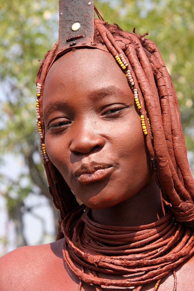 The Himba Tribe Woman carries a sense of pride in their ethos and customs and prefer to maintain their cultural values by following the age old traditions along with their complex hairdo system. This is to them their Beauty of existence with Nature.