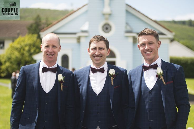 The groomsmen outside the powder blue Lady of the Wayside church in Glenmalure. Wedding at Summerhill House Hotel by Couple Photography.