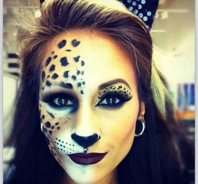 Cool Halloween leopard face makeup.
