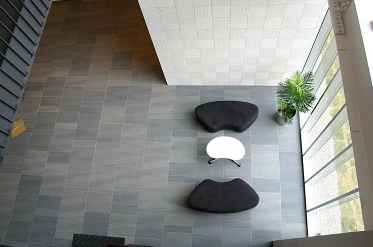 Decoration: Awesome Floor Tiling As Well As Pair Of Black Sofa Also Curved White Coffee Table Design Ideas: Creative Wall Tiles Accessories from Japan in Some Style