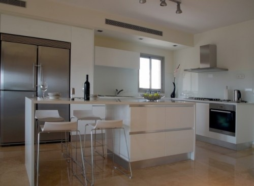 In A More Modern Style Kitchen Transitioning The Island Into A Table With Seating On Both Sides