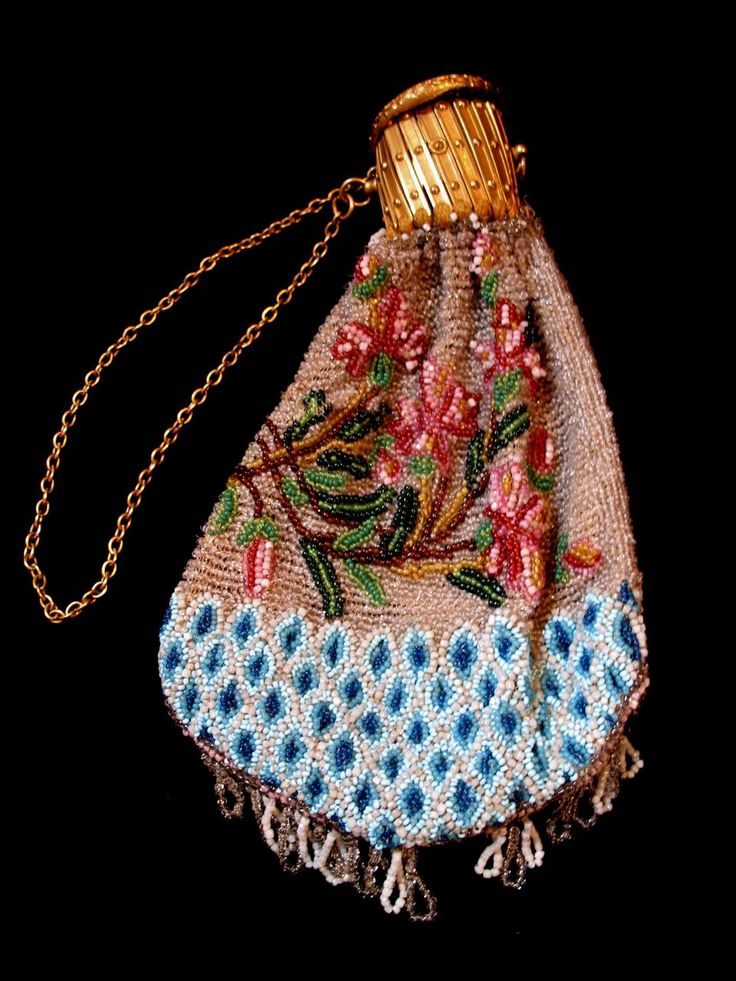French lady's coin purse from the Napoleon III era, circa 1860-1880, all hand beaded with exquisite motifs, and with a gilt fastener.