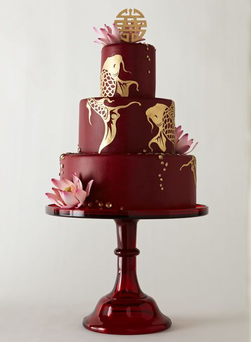 Japanese garden-inspired, with koi, lotus blossoms, and the double-happiness symbol #weddings #weddingcake