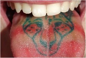 Getting Real Tongue Tattoos - http://sicktattoos.org/getting-real-tongue-tattoos/