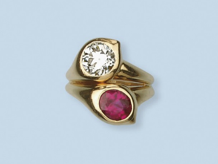 A GOLD, RUBY AND DIAMOND 'TOI ET MOI' RING, BY RENE BOIVIN   Of cross-over design, collet-set with an oval-shaped ruby and circular-cut diamond within a paisley-shaped surround to the bifurcated gold band, French assay mark for gold  Accompanied by a certificate of authenticity from Francoise Cailles stating that the ring is by Boivin, 197