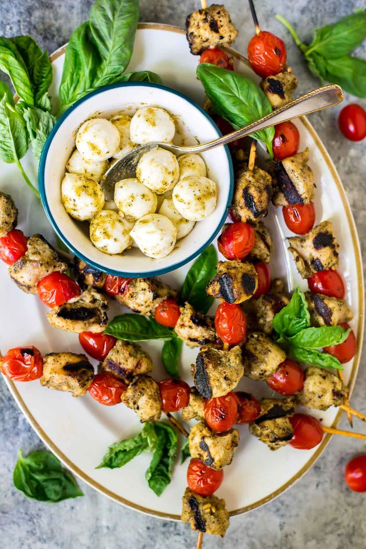 These Grilled Pesto Chicken Kabobs are the perfect summer dish! EASY recipe with ONLY THREE INGREDIENTS — Serve as appetizer at your next backyard bash, or have the skewers for dinner any night of the week. Healthy and delicious! @wellplated