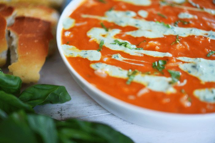 Tomato soup with rice and basil yogurt drizzle  Let me clarify--homemade tomato soup.  When I was younger, I was addicted to cans of the Progresso version.  I can picture myself at age 22, squeezing my way into my 2x2 foot kitchen,  cracking open that blue can, and then waiting those 2 min